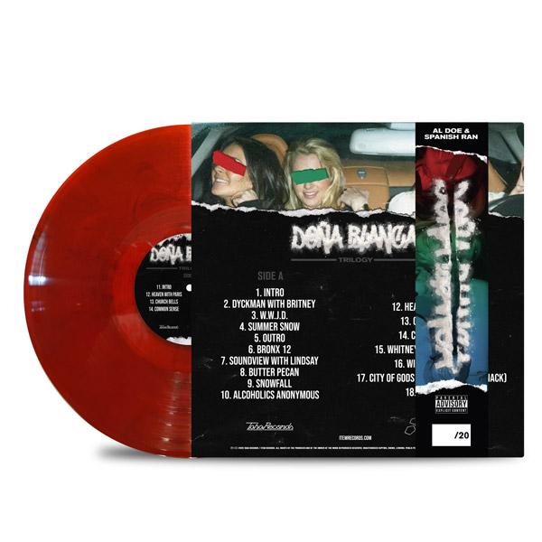 AL_DOE_SPANISH_RAN_DONA_BLANCA_TRILOGY_BACK_Side_Cover_TRANSPARENT_RED_WITH_BLACK_SMOKE_DONA_STRIP_Vinyl_LP
